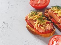 Homemade delicious sandwich with sausage, tomatoes and cheese Royalty Free Stock Photography