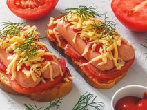Homemade delicious sandwich with sausage, tomatoes and cheese. Healthy fast food Stock Image