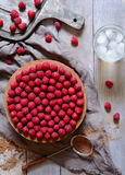 Homemade delicious tiramisu cake with fresh raspberries and lemonade on the rustic wooden table. Stock Photos