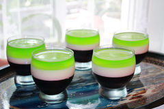 Homemade dessert. Gelatin dessert in the home of three colored layers Royalty Free Stock Photography