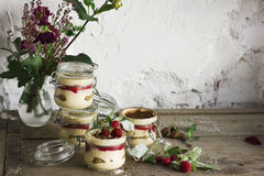 Homemade dessert tiramisu with raspberries in the glass jar Royalty Free Stock Photos