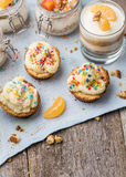 Homemade desserts - biscuits with yogurt, tangerines and walnuts in glass, oats with fresh fruit in glass jar and Stock Photos