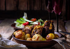 Homemade dish with baked potatoes and veal Royalty Free Stock Images