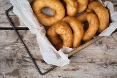 Homemade donuts with icing sugar powder on wooden background royalty free stock image
