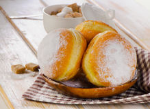Homemade Donuts with powdered sugar on  wooden plate. Stock Photo