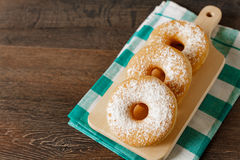 Homemade donuts on rustic dark table Stock Photo