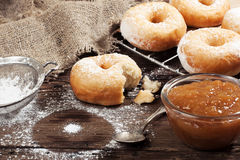 Homemade donuts on wooden table Royalty Free Stock Image