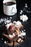 Homemade Double Chocolate Cake with Crushed Meringues, Wafer Rolls, a Ripe Berry on Top and Coffee Royalty Free Stock Photography