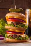 Homemade double-decker burger. Big portion serving.  Royalty Free Stock Photography