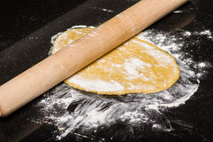 Homemade dough being formed into pasta Royalty Free Stock Photo