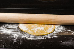 Homemade dough being formed into pasta Royalty Free Stock Photography