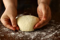 Homemade dough Shaping on wooden board stock photo