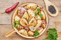 Homemade dumplings with mushroom stuffing. On a rustic table Stock Photography