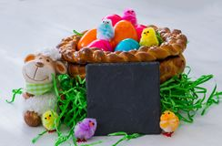 A homemade Easter basket with a blank blackboard. stock photos