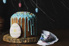 Homemade Easter cake with raisins and in sugar glaze. Russian homemade Easter cake with raisins and in sugar glaze royalty free stock photos