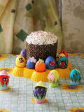 Homemade Easter cakes. In the surroundings decorated eggs on the kitchen table Royalty Free Stock Image