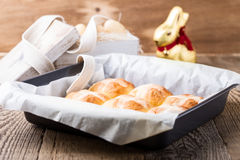 Homemade Easter hot cross buns in bakery tray Royalty Free Stock Images