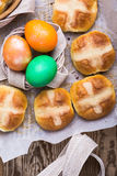 Homemade Easter hot cross buns and eggs, top view Royalty Free Stock Image