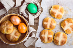 Homemade Easter hot cross buns and eggs, top view Royalty Free Stock Images