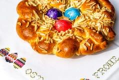 Festive bakery - Homemade Easter traditional bread. Homemade Easter traditional bread decorated with colorful eggs, festive bakery Royalty Free Stock Photos