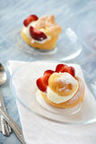 Homemade eclairs with strawberries Royalty Free Stock Photos