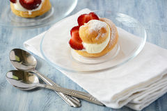 Homemade eclairs with strawberries Royalty Free Stock Photo