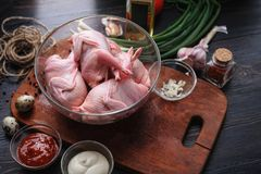 Homemade eco-friendly raw quails ready for cooking.  Royalty Free Stock Image