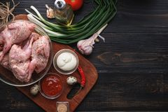 Homemade eco-friendly raw quails ready for cooking. Stock Image