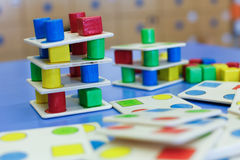 Homemade educational wooden colorful game. Do-it-yourself educational wooden colorful game, made for stacking, arranging and building. Learning through Stock Photography