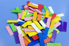 Homemade educational wooden colorful toys. Do-it-yourself educational wooden colorful sticks, made for stacking, arranging and building. Learning through Royalty Free Stock Photos
