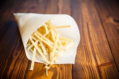 Homemade egg noodles in a paper package Stock Images