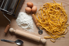Homemade egg pasta. Top view of homemade egg pasta and ingredients Royalty Free Stock Photos