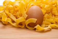 Homemade egg pasta on a cutting board. Uncooked homemade egg pasta on a cutting board Royalty Free Stock Photography