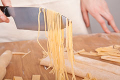 Homemade Egg Pasta Lifted up with a Knife Royalty Free Stock Photos