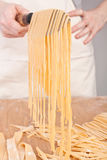 Homemade Egg Pasta Lifted up on a Knife Stock Image