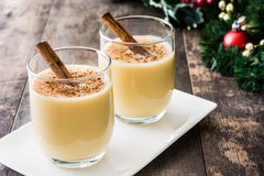 Homemade eggnog with cinnamon on wood. Typical Christmas dessert. Stock Photography