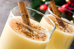 Homemade eggnog with cinnamon on wood. Typical Christmas dessert. Homemade eggnog with cinnamon on wooden table. Typical Christmas dessert stock photos