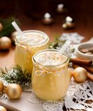 Homemade Eggnog, traditional Christmas drink served with  whipped cream and nutmeg Stock Image