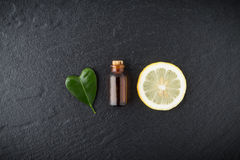 Homemade essential oil concept. Bottle essential oil with slice stock image