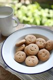Homemade face cookies and milk Royalty Free Stock Photography