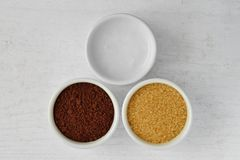 Homemade face scrub made out of coconut oil, coffee powder and b royalty free stock images