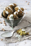 Homemade falafel balls with dripping yogurt sauce on little bowl Royalty Free Stock Photography