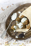 Homemade falafel balls with yogurt sauce on paper cornet and spoon Stock Photo