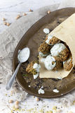 Homemade falafel balls with yogurt sauce on paper cornet and spoon Royalty Free Stock Photography