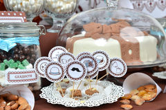 Homemade fancy set table with sweets candies. Cake, marshmallows, zephyr, nuts, almonds, truffle as a present for birthday party Stock Image