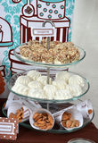 Homemade fancy set table with sweets candies,. Cake, marshmallows, zephyr, nuts, almonds, truffle as a present for birthday party Royalty Free Stock Photography