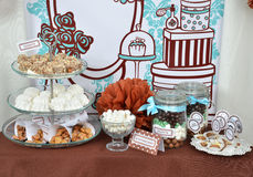 Homemade fancy set table with sweets candies. Cake, marshmallows, zephyr, nuts, almonds, truffle as a present for birthday party Royalty Free Stock Photography