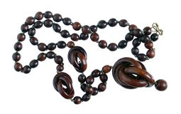 Homemade female beads are made of african ebony wood dark red b stock images