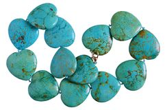 Homemade female beads are made of heart shapes smooth green an. D blue malachite striped stones. Isolated royalty free stock photos