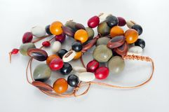 Homemade female beads are made of multi-colored smooth polished royalty free stock image